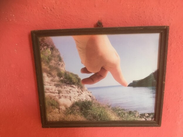 Photo of a photo from a wall in Omar Perez's apartment in Havana